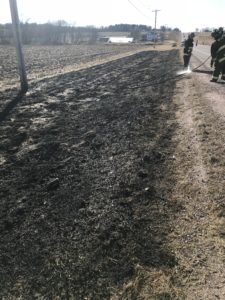 Wildland Firefighters and local fire departments suppressing a wildland fire in Sauk County near Rock Springs