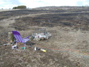 A campfire spread to nearby dry vegetation and caused a wildfire.