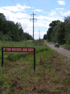 Signs along an ATV route: If the woods are dry, and the winds are high, before your next turn, think before you burn!