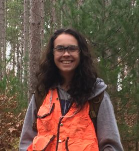 New forest health specialist Alex Feltmeyer in woods.