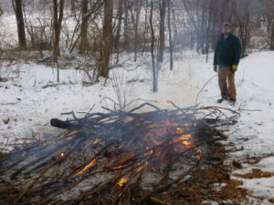 Burning brush when the ground is completely snow covered.