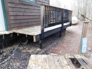 Leaf and needle debris under decks can ignite and start the deck and house on fire.