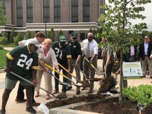DNR Secretary Cole, DNR staff and former Packers Johnnie Gray and Gerry Ellis planting a tree.