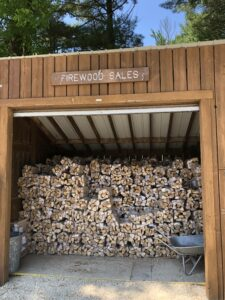 Photo of firewood bundles for sale.